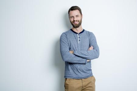 A Portrait of a men in studio gray background Foto de archivo