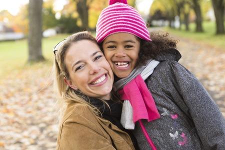 black  family: A Happy family having fun on beautiful autumn day