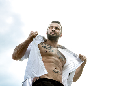 nudist: A sexy man with tattoo outside taking good time