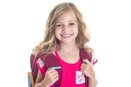 Een klein meisje met rugzak, school, het leren, kennis, op een witte achtergrond Stockfoto