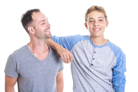 A stepfather and son standing isolated on white background