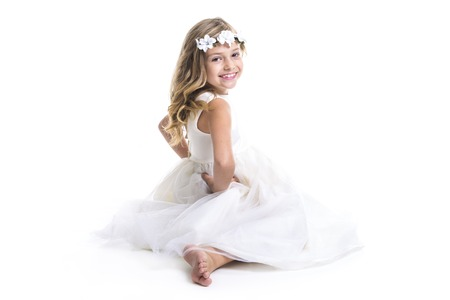little blonde girl: A Little girl wearing white dress on studio