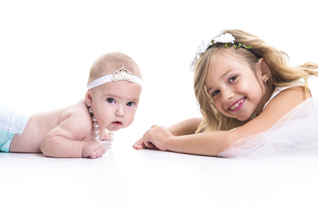 3 4 years: A portrait of two sisters in white dresses Stock Photo