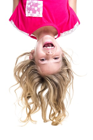kids jumping: A Little girl with upside down head