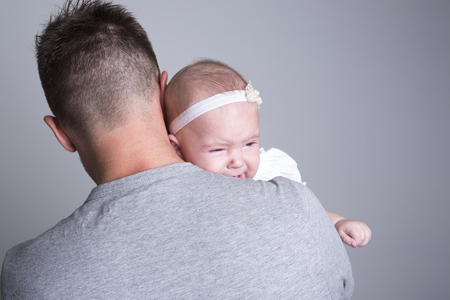 lament: A baby who cry on the hand of is father