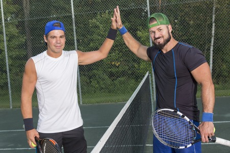 Two tennis players having fun to play Imagens