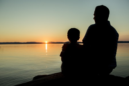 shadow: A Father with is son at the sunset