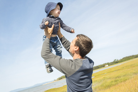 father: A father play with is son on the side of the beach Stock Photo