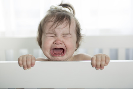 sad cute baby: crying baby girl Stock Photo
