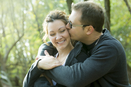 A Happy middle aged couple outdoors on beautiful autumn day Imagens