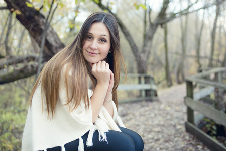 16s: A Beautiful autumn woman in golden park