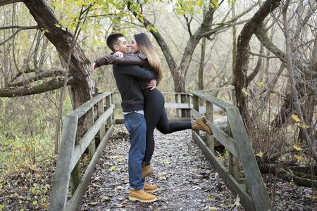 tenderness: A nice teen couple at autumn park