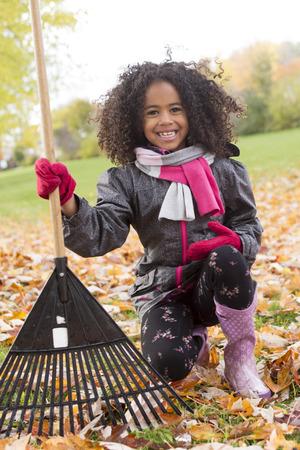 A Child on autumn season portrait having fun outside