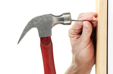 A Hammer nail hit in front of a white background Imagens
