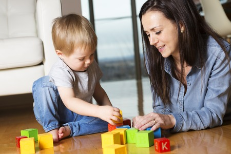 mom and son: A mother play block with his son at home