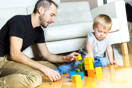 old building: A father play block with his son at home Stock Photo