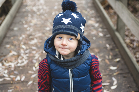 warm clothing: A boy in the park.  Portrait of a boy on autumn park