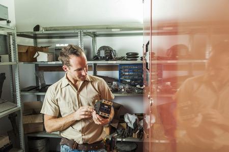 trading floor: An Elevator Repair Man at work employee