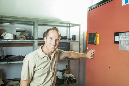 parer: An Elevator Repair Man at work employee