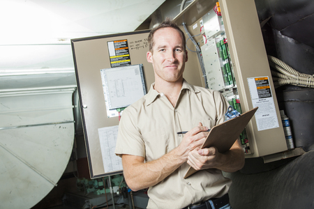 A Air Conditioner Repair Man at work Archivio Fotografico