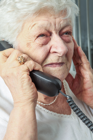 congenial: A portrait of an elderly woman on the phone