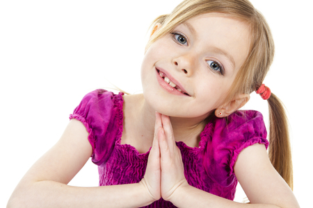 child laughing: A beautiful girl child wearing a pink clothe and sit on the floor over a white background. Stock Photo