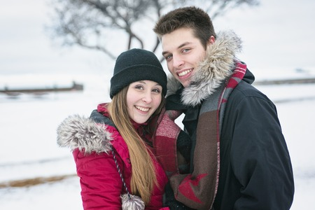two boys: Two nice teenagers havinf fun on the snow field Stock Photo