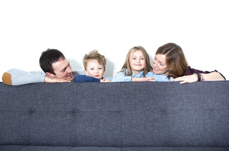 livingroom: A Nice family sit on the livingroom sofa