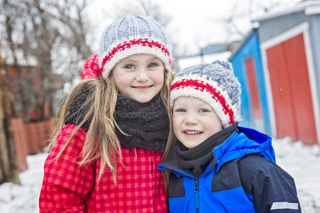 7 year old boys: A family Brother and sister portrait in winter time