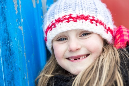 8 years: A Close portrait of happy 8 years old Caucasian girl outside in winter