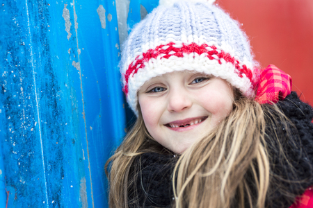 8 years old: A Close portrait of happy 8 years old Caucasian girl outside in winter