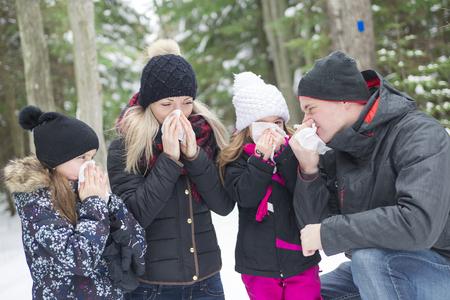hanky: A family holding tinnue virus outside in winter season Stock Photo