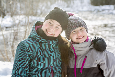 7 9 years: Two happy childrens sister on the snow in winter