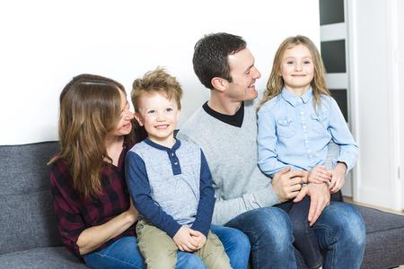 family sofa: A Nice family sit on the livingroom sofa