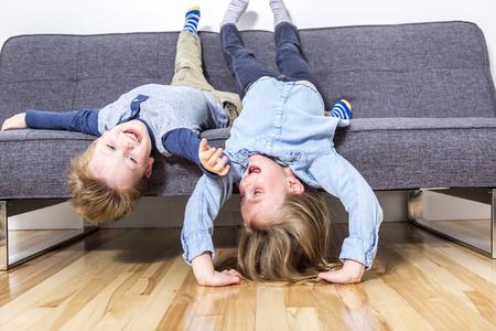 sofa: two nice beautiful child boy and girl on sofa