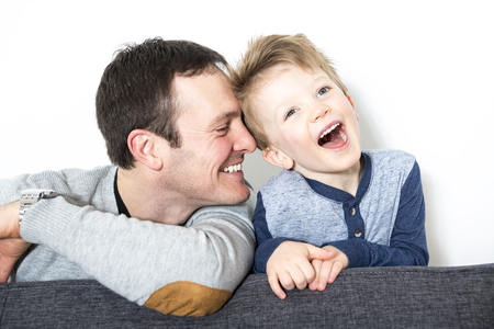 30 to 40 year old: A nice closeup of father and son at home