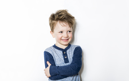 seven years: Portrait of seven years old boy on gray background