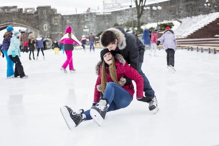 iceskates: A Ice skating couple having winter fun on ice skates Quebec, Canada.