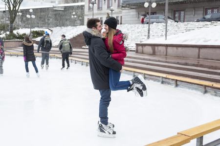 iceskating: A Ice skating couple having winter fun on ice skates Quebec, Canada.