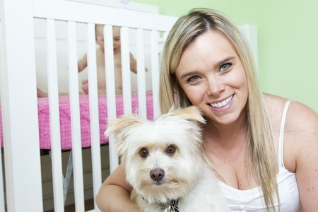 A Mother and baby with dog in the baby room Stock Photo