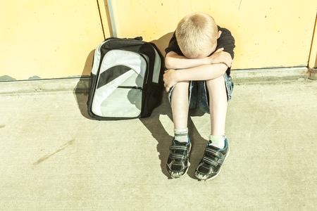 school playground: A boy bullying in school playground. very sad! Stock Photo