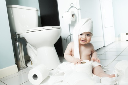 ornery: Toddler ripping up toilet paper in bathroom