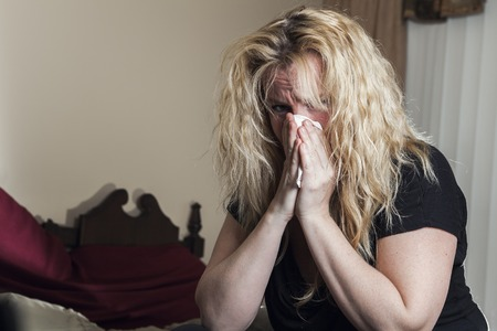 hanky: Young woman having flu, feeling bad, blowing her nose,