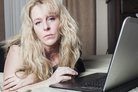 depress: A woman inside is bedroom feel depress.