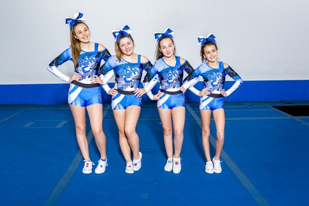 cheerleading squad: A Portrait of beautiful cheerleaders  in action