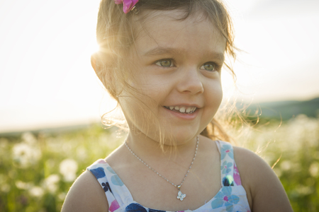 five years old: A Portrait of five years old caucasian child girl sunset