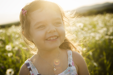 five years': A Portrait of five years old caucasian child girl sunset