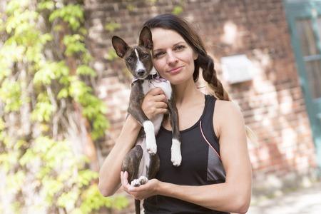 A woman portait with dog in city street Stok Fotoğraf