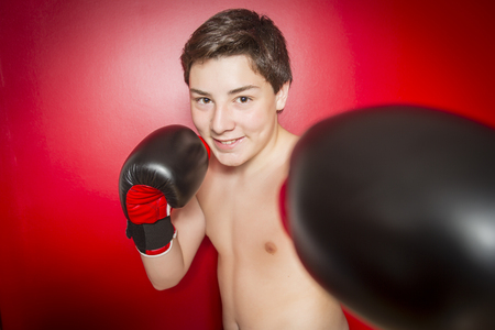 A Close-up photo of a boxer with red gloves