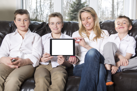 family sofa: An attractive happy, family of mother, son sitting on sofa Stock Photo